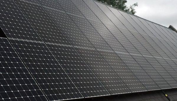 black frame, white backing, wired solar panel